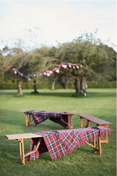 Tartan blankets on a bench outdoors